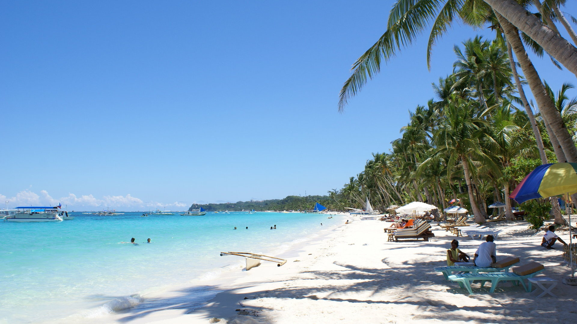 Beach wallpaper. Beautiful white sand, blue ocean, blue sky on Boracay island